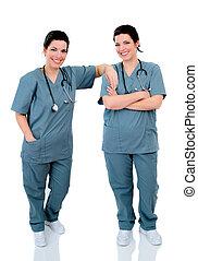 Twin Nurses - Twin Hospital Nurses Stood On A Reflective...