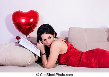 Girl lying down on sofa