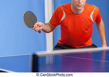 Playing table tennis. Confident young men playing table...