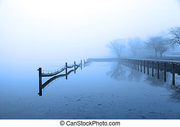 Quite lake in winter time - Mist over the lake on winter...