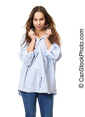 Young woman with long hair grinning and holding shirt