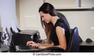 Printing document - Woman typing on a laptop Sends the...