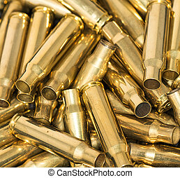 Pile of empty bullet shells - Abstract of pile of empty...