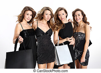 Women shopping in a boutique - Group of four friends in sexy...