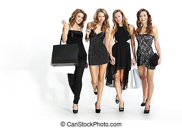 Shopping - Group of four friends in sexy dresses with...