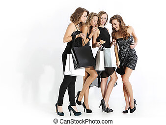 Group of girls looking at shopping - Group of four friends...