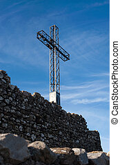 La Rocca, Italy, cross on background of sky