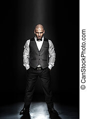 Elegant handsome man posing. - Fashion shot of an elegant...