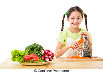 Girl grate the carrots - Smiling girl grate the carrots,...