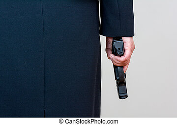 Woman holding hand gun on white background - Close up of a...
