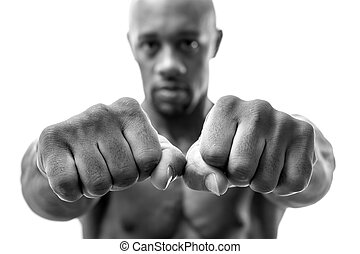 Fists and Knuckles - Muscular man of African descent...