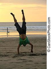 gymnast on a beach