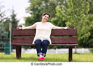 Woman on Bench Expressing her Positivity - Woman on brown...
