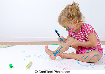 Cute Toddler Painting Her Legs Carefully