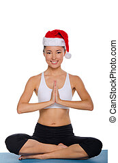 Smiling asian in Santa Claus hat Isolated on white