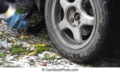 Process of wheel changing on the road - Changing a car...