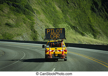 pilot car - road construction ahead you must follow the...