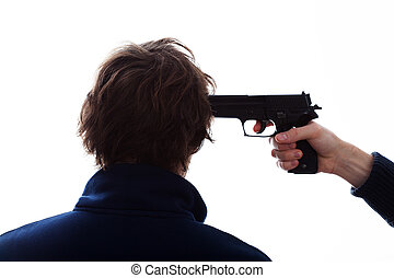 Threatening with a gun - Bandit threatening the man with a...