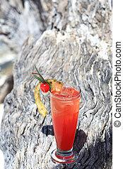 fruit cocktail on a tropical island beach