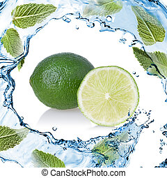 water splash with lime and green mint isolated on white