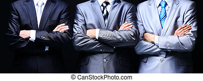 Group portrait of a professional business teamon dark background