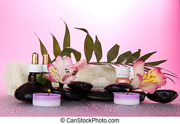 Candle, flower, stones with water decrease, before a howea...