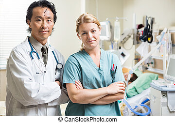 Confident Doctor And Nurse In Hospital - Portrait of...