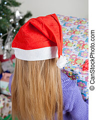 Rear View Of Girl With Christmas Gift