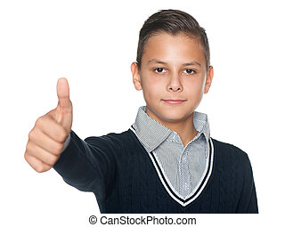 Preteen boy holds his thumb up