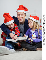 Father With Children Reading Book During Christmas - Full...