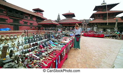 Female tourist choosing souvenir at Patan Durbar Square,...