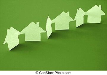 real estate - paper houses or homes showing a concept for...