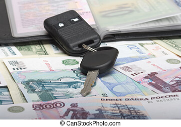 autodocuments and a car key - Black wallet with...