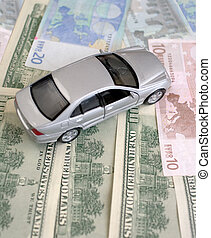 The silvery car on euro and dollars