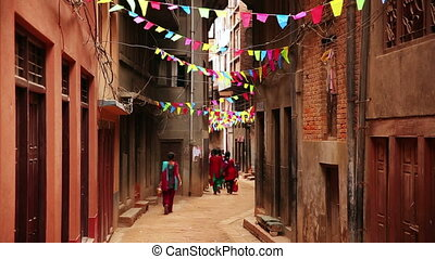 People walking along narrow lane, Kathmandu, Nepal - People...