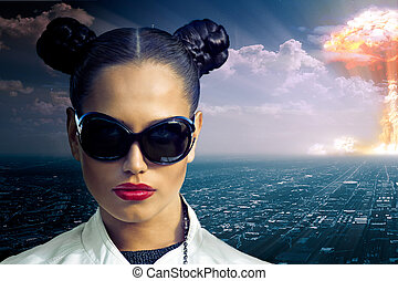 nuclear explosion - girl super hero on the background of the...