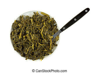 Cooked collard greens in a small dish with a fork - Top view...