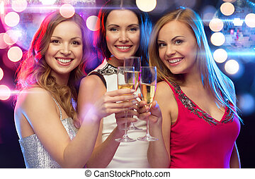 three smiling women with champagne glasses - new year,...