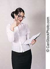 Attractive secretary holding papers