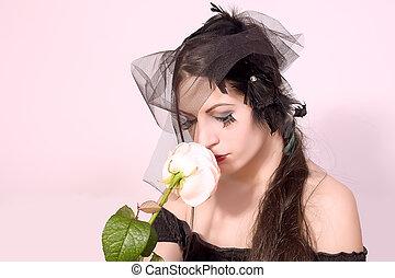 Black widow woman holding flower - portrait of black widow...