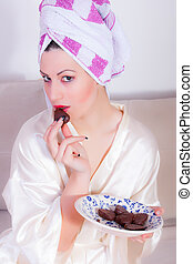 Beautiful girl is eating chocolate - portrait of beautiful...