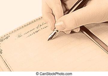 Nostalgia - Female hand writing empty page in diary with...
