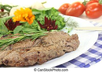 fried Sirloin steak with wild herb salad