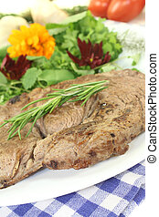 Sirloin steak with wild herb salad and rosemary