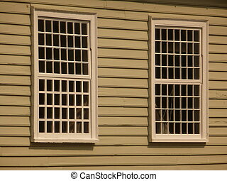 Lattice Windows - Two white lattice wooden windows in a...