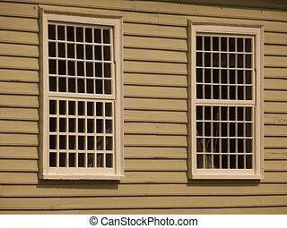 Lattice Windows - Two white lattice wooden windows in a...