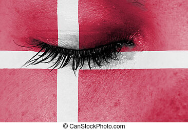 Crying woman, pain and grief concept, flag of Denmark