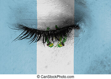 Crying woman, pain and grief concept, flag of Guatemala