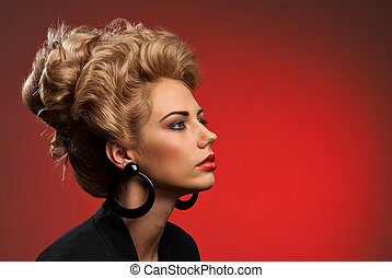 Fashion photo of attractive young woman with styled hair