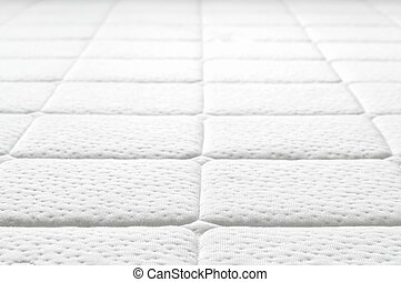 Close-up of white mattress texture. Patter of quilted...